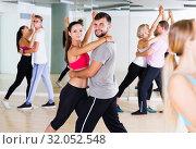 Купить «smiling young adults dancing salsa», фото № 32052548, снято 9 октября 2017 г. (c) Яков Филимонов / Фотобанк Лори
