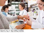 Купить «Nail masters performing manicure», фото № 32052656, снято 28 апреля 2017 г. (c) Яков Филимонов / Фотобанк Лори