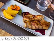 Купить «Pork with wine sauce», фото № 32052668, снято 11 июля 2020 г. (c) Яков Филимонов / Фотобанк Лори