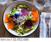 Купить «Appetizing salad with endive, palms hearts, avocado and radish», фото № 32052680, снято 26 августа 2019 г. (c) Яков Филимонов / Фотобанк Лори