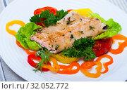 Купить «Image of fried trout fillets served with peppers and greens served», фото № 32052772, снято 23 августа 2019 г. (c) Яков Филимонов / Фотобанк Лори