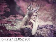 Fairytale girl in beautiful stones. Stones in the moss. Стоковое фото, фотограф Анатолий Лиясов / Фотобанк Лори
