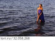 Купить «Beautiful girl stands in the sea», фото № 32058268, снято 2 августа 2019 г. (c) Марина Володько / Фотобанк Лори