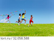 Купить «Group of kids run very fast with color ribbons», фото № 32058588, снято 15 июня 2019 г. (c) Сергей Новиков / Фотобанк Лори