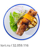 Купить «Top view of baked pork rib with cheese and eggplant», фото № 32059116, снято 1 апреля 2020 г. (c) Яков Филимонов / Фотобанк Лори