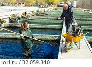 Купить «Male and female catching fish from reservoir», фото № 32059340, снято 19 марта 2019 г. (c) Яков Филимонов / Фотобанк Лори
