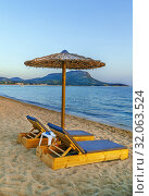 Купить «Thatched umbrellas, Chalkidiki, Greece», фото № 32063524, снято 13 июня 2019 г. (c) Boris Breytman / Фотобанк Лори