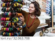 Купить «Female showing different bracelets», фото № 32063708, снято 27 апреля 2017 г. (c) Яков Филимонов / Фотобанк Лори