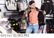 Купить «customer is trying up modern jacket», фото № 32063952, снято 1 сентября 2017 г. (c) Яков Филимонов / Фотобанк Лори