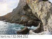 Купить «Грот Голицына (Эстрадный, Шаляпина) - крупный естественный грот, выбитый морскими волнами в горе Коба-Кая (Пещерная) неподалеку от поселка Новый Свет в Крыму. Весенний день», фото № 32064252, снято 9 марта 2019 г. (c) Наталья Гармашева / Фотобанк Лори