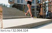 Купить «young woman running downstairs», видеоролик № 32064324, снято 4 августа 2019 г. (c) Syda Productions / Фотобанк Лори
