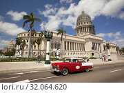 Купить «Old American car used as taxi in front of the Capitolio building in Central Havana, La Habana, Cuba, West Indies, Central America», фото № 32064620, снято 16 апреля 2018 г. (c) age Fotostock / Фотобанк Лори