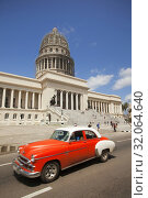 Купить «Old American car used as taxi in front of the Capitolio building in Central Havana, La Habana, Cuba, West Indies, Central America», фото № 32064640, снято 16 апреля 2018 г. (c) age Fotostock / Фотобанк Лори
