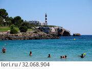 Spain, Mallorca - lighthouse in Portocolom (2018 год). Редакционное фото, агентство Caro Photoagency / Фотобанк Лори