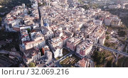 Купить «Aerial view of Alcoi cityscape with blue dome of Archpriest church of Santa Maria, Spain», видеоролик № 32069216, снято 16 апреля 2019 г. (c) Яков Филимонов / Фотобанк Лори