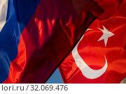 Купить «Государственные флаги Российской Федерации и Турецкой Республики развиваются на ветру», фото № 32069476, снято 23 августа 2019 г. (c) Николай Винокуров / Фотобанк Лори