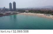Купить «Aerial panoramic view of modern Barcelona cityscape on Mediterranean coast», видеоролик № 32069508, снято 7 июля 2019 г. (c) Яков Филимонов / Фотобанк Лори