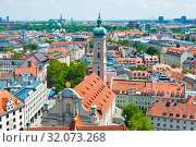 Купить «Cityscape of Munich and the Heilig-Geist-Kirche (Church of the Holy Spirit;  Holy Ghost Church). Sunny summer day. View from above. Bavaria. Germany», фото № 32073268, снято 18 июня 2019 г. (c) E. O. / Фотобанк Лори