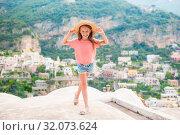 Купить «Adorable little girl on warm and sunny summer day in Positano town in Italy», фото № 32073624, снято 15 июня 2019 г. (c) Дмитрий Травников / Фотобанк Лори