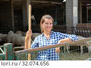 Купить «Successful woman farmer in enclosure with sheeps», фото № 32074656, снято 17 ноября 2019 г. (c) Яков Филимонов / Фотобанк Лори