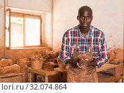 Portrait of potter in workshop. Стоковое фото, фотограф Яков Филимонов / Фотобанк Лори