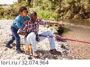 Купить «Man and boy fishing with rods», фото № 32074964, снято 26 мая 2019 г. (c) Яков Филимонов / Фотобанк Лори