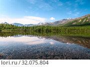 Купить «Clear water of the lake at sunny summer day. The Khibiny Mountains is on Kolsky Peninsula, northern Russia», фото № 32075804, снято 6 июля 2010 г. (c) Кекяляйнен Андрей / Фотобанк Лори