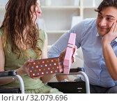 Купить «Man making marriage proposal to disabled woman on wheelchair», фото № 32079696, снято 10 апреля 2017 г. (c) Elnur / Фотобанк Лори