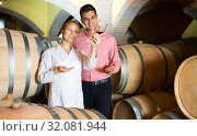 Купить «Sommelier advising male customer in winery cellar», фото № 32081944, снято 21 сентября 2016 г. (c) Яков Филимонов / Фотобанк Лори