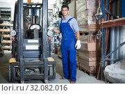 Купить «Portrait of workman in uniform on his workplace», фото № 32082016, снято 26 июля 2017 г. (c) Яков Филимонов / Фотобанк Лори