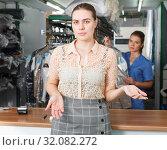 Купить «Dissatisfied woman customer of dry cleaning», фото № 32082272, снято 9 мая 2018 г. (c) Яков Филимонов / Фотобанк Лори