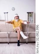Купить «Young man after accident recovering at home», фото № 32082996, снято 3 мая 2019 г. (c) Elnur / Фотобанк Лори