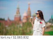 Happy young urban woman drinking coffee in european city. Стоковое фото, фотограф Дмитрий Травников / Фотобанк Лори