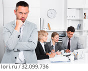 Купить «Irritated businessman in office with working associates», фото № 32099736, снято 1 июля 2017 г. (c) Яков Филимонов / Фотобанк Лори