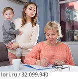 Купить «Two women are having disagreements with filling utility bills», фото № 32099940, снято 15 февраля 2018 г. (c) Яков Филимонов / Фотобанк Лори