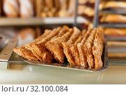 Купить «Tray with sweet pastry on bakery showcase», фото № 32100084, снято 12 ноября 2018 г. (c) Яков Филимонов / Фотобанк Лори