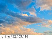 Купить «Небесный закатный пейзаж. Sunset evening dramatic sky background - picturesque colorful clouds lit by sunlight. Vast sky landscape panoramic scene, colorful sky view», фото № 32105116, снято 14 июня 2018 г. (c) Зезелина Марина / Фотобанк Лори