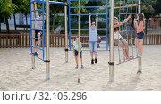 Купить «Glad children playing at the playground», видеоролик № 32105296, снято 23 июля 2018 г. (c) Яков Филимонов / Фотобанк Лори
