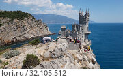 Купить «Gaspra, Crimea - July 7. 2019. Castle of Swallows Nest on the Cape Ai-Todor of Black Sea coast», видеоролик № 32105512, снято 30 августа 2019 г. (c) Володина Ольга / Фотобанк Лори