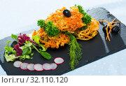 Купить «Tasty fried vegetarian carrots cutlets with greens served at plate», фото № 32110120, снято 19 сентября 2019 г. (c) Яков Филимонов / Фотобанк Лори