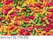 Купить «Bright multi-colored background of painted foam rice», фото № 32110252, снято 23 августа 2019 г. (c) ok_fotoday / Фотобанк Лори
