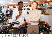 Купить «Young couple looking for new motorcycle in salon, dissatisfied woman expressing displeasure», фото № 32111900, снято 16 января 2019 г. (c) Яков Филимонов / Фотобанк Лори