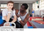 Купить «Coach comforting boy at gym», фото № 32111960, снято 17 января 2019 г. (c) Яков Филимонов / Фотобанк Лори