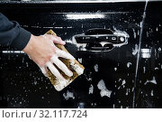 Купить «car door with foam and a hand with a foam sponge», фото № 32117724, снято 2 сентября 2019 г. (c) Дмитрий Бачтуб / Фотобанк Лори