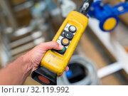 Купить «Industrial worker pushing on button of machinery control panel in manufactury.», фото № 32119992, снято 29 февраля 2020 г. (c) easy Fotostock / Фотобанк Лори