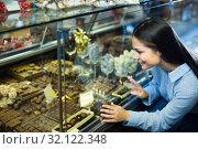 Купить «woman selecting chocolates», фото № 32122348, снято 1 апреля 2020 г. (c) Яков Филимонов / Фотобанк Лори