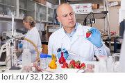 Купить «Scientist checking agricultural products», фото № 32122380, снято 24 января 2019 г. (c) Яков Филимонов / Фотобанк Лори