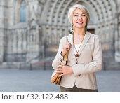 Купить «Adult woman 50s years old is walking in classic dress», фото № 32122488, снято 3 сентября 2017 г. (c) Яков Филимонов / Фотобанк Лори