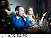 Unhappy couple celebrating New Year. Стоковое фото, фотограф Яков Филимонов / Фотобанк Лори