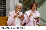 Купить «senior women eating takeaway food on city street», видеоролик № 32123068, снято 25 августа 2019 г. (c) Syda Productions / Фотобанк Лори